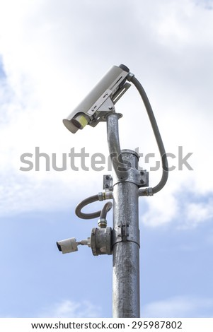 Outdoor CCTV Camera on the Pole with Blue Sky - stock photo