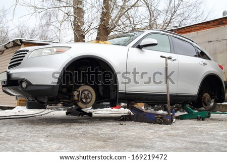 Outdoor changing car wheels on service in winter