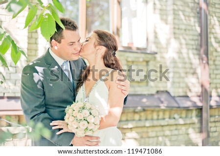 outdoor close up photo of beautiful couple kissing