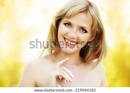 outdoor closeup portrait of a beautiful blonde middle aged woman