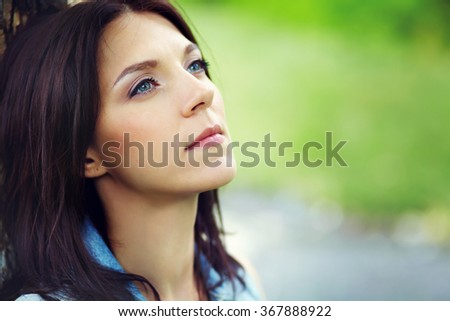 outdoor closeup portrait of an attractive middle aged woman