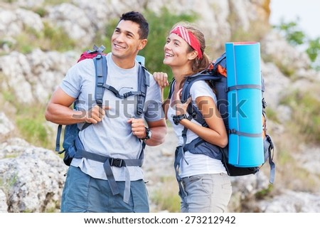 Outdoor. Couple - active hikers hiking enjoying view looking at mountain forest landscape in Yosemite National Park, California, USA. Happy multiracial outdoors couple, young Asian woman and Caucasian - stock photo