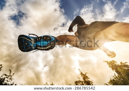Outdoor cross-country running low angle view under runner concept for exercising, fitness and healthy lifestyle - stock photo