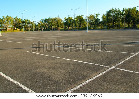 Outdoor empty parking lot with blue skies - stock photo