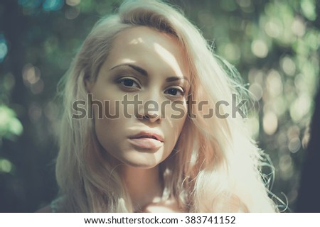 Outdoor fashion photo of young beautiful blonde lady - stock photo