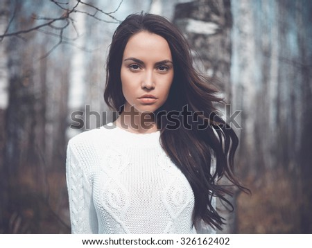 Outdoor fashion photo of young beautiful lady in a birch forest - stock photo