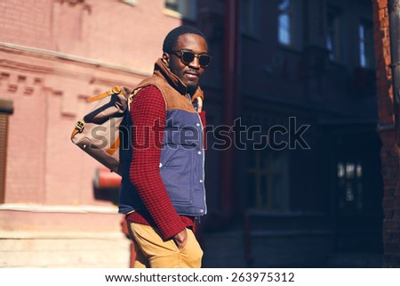 Outdoor fashion portrait of handsome stylish african man in evening - stock photo