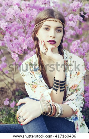Outdoor fashion portrait of young beautiful woman. Boho chic style, details - stock photo