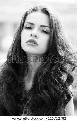 outdoor fashion portrait of young beautiful woman with long dair hair - stock photo