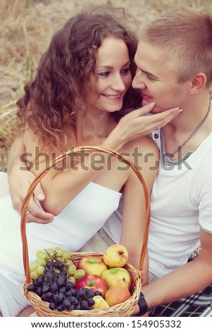 outdoor fashion portrait of young sensual couple. love and kiss