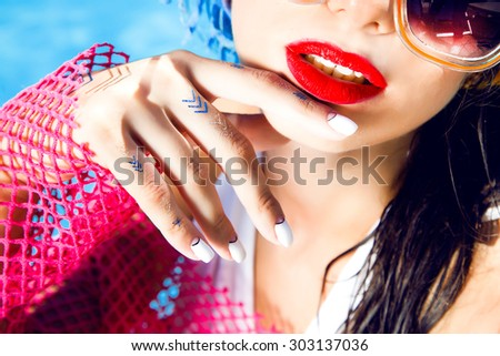 Outdoor fashion portrait of young sexy woman with perfect nail polish,gold flash tattoo,Nice sunny summer hot day.bright summer colors,wet hair,shellac,accessory,jewelry,mouth,red lips,toned,tan skin - stock photo