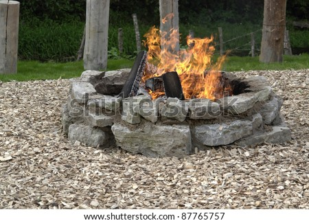 outdoor fireplace with burning fire - stock photo