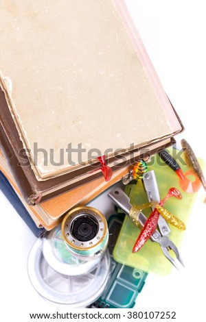 outdoor fishing tackles and baits with books on white background