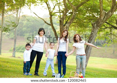 Outdoor fun Asian family in morning