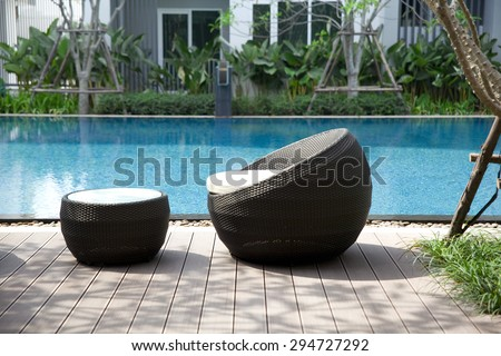 outdoor furniture rattan chairs and table on terrace - stock photo