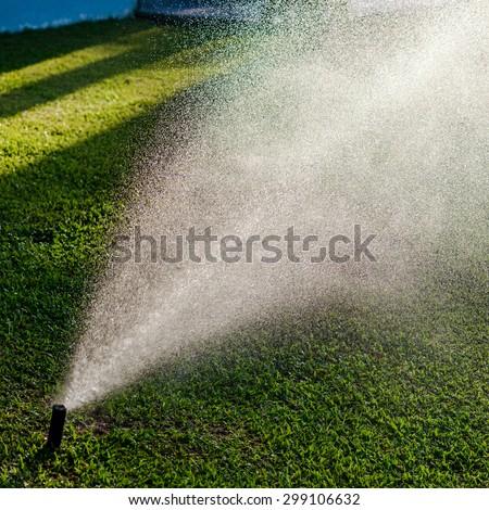 Outdoor garden lawn maintenance sprinkler watering system - stock photo