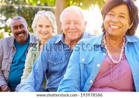 Outdoor Group Portrait Of Senior Friends - stock photo