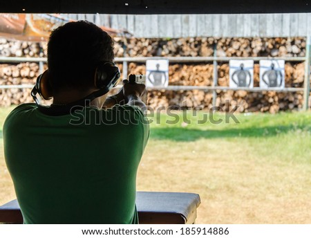 Outdoor gun shooting of target range. - stock photo
