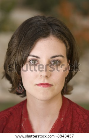 Outdoor head shot of an attractive 30 year old female model. - stock photo