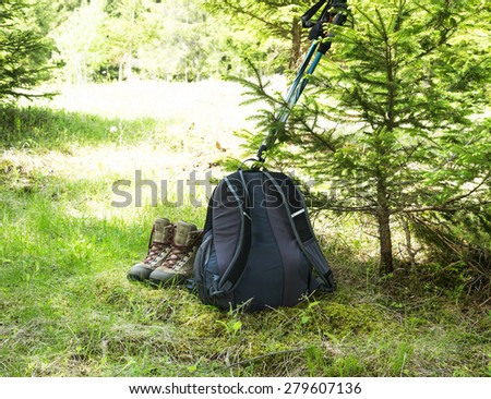 Outdoor Hiking and Trekking Boots,Backpack and Poles in the Forest - stock photo