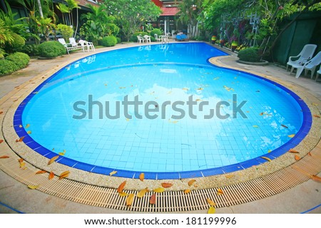 Outdoor in ground residential swimming pool in backyard with hot tub - stock photo