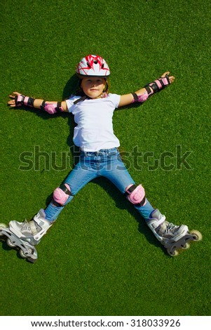 Outdoor lifestyle young girl portrait on the roller skate in the stadium at sunny wheather - stock photo