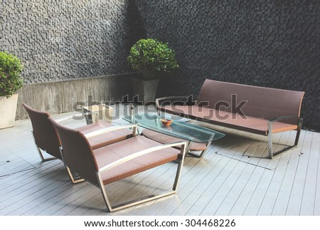Outdoor luxury bench in smoking area zone  - stock photo