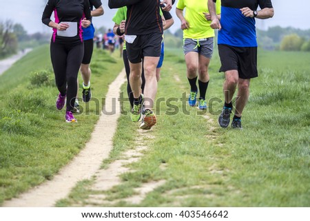 Outdoor marathon cross-country running fitness and healthy lifestyle - stock photo