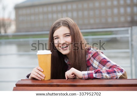 Outdoor natural face portrait of a beautiful young woman - stock photo