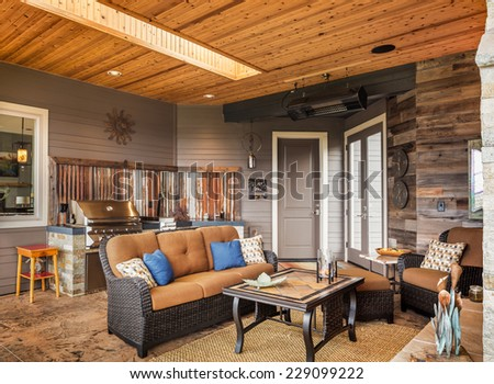 Outdoor Patio with Barbecue, Grill, Couch, and Skylight - stock photo