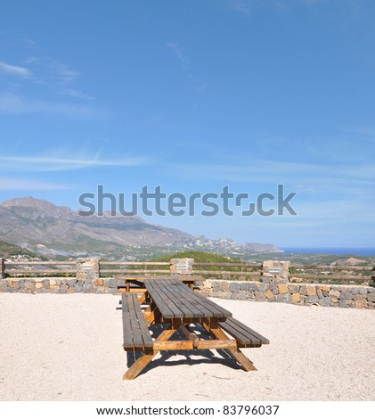 Outdoor Picnic Tables in Polop a Costa Blanca Town in the Province of Alicante Spain Europe overlooking nearby Coastal City Altea