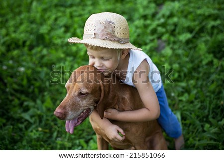 Outdoor portrait: Child love his Hungarian Vizsla - stock photo