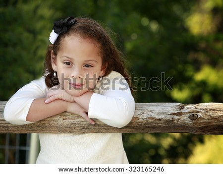 Outdoor portrait of a beautiful African American little girl - stock photo
