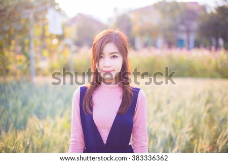 Outdoor portrait of a beautiful asian girl vintage tone. - stock photo