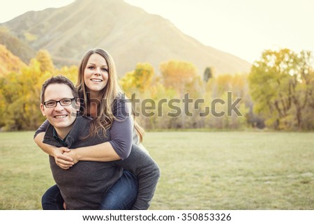 Outdoor portrait of a beautiful middle aged couple - stock photo