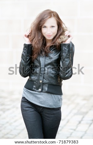 Outdoor portrait of a beautiful young woman in winter - stock photo