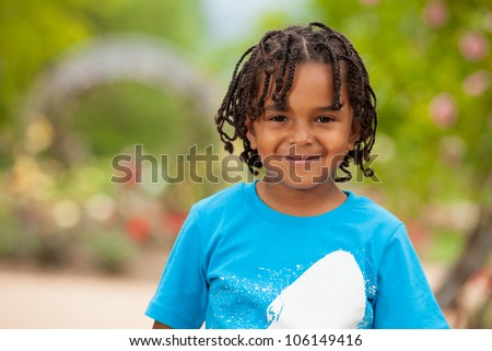 Outdoor portrait of a cute african american little boy - stock photo