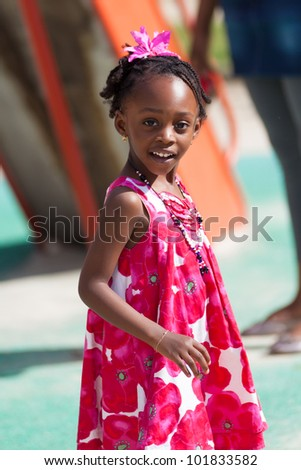 Outdoor portrait of a cute african american little girl - stock photo