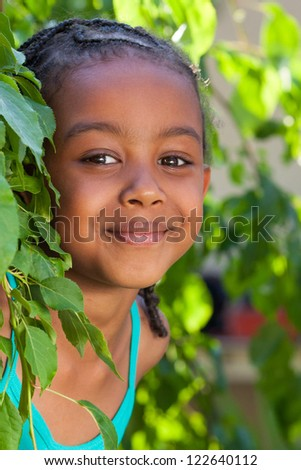 Outdoor portrait  of a cute little African American girl - stock photo