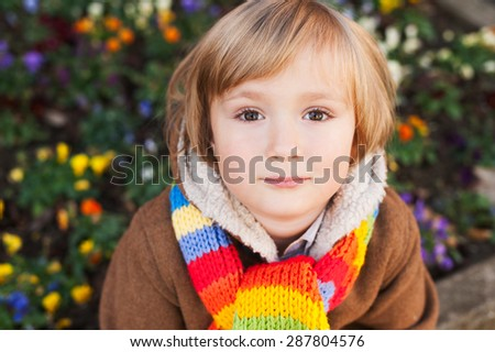 Outdoor portrait of a cute little boy on a nice cold day - stock photo