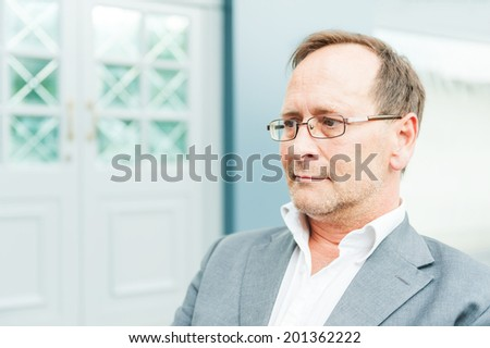 Outdoor portrait of a handsome man resting after work - stock photo