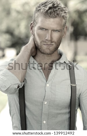 Outdoor portrait of a handsome young confident man - stock photo