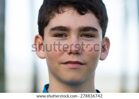 Outdoor portrait of a handsome young male teenager - stock photo