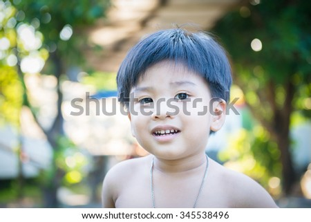 outdoor portrait of a little asian boy at the evening light.