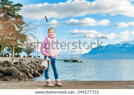 Outdoor portrait of adorable little girl - stock photo