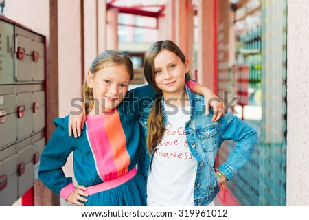 Outdoor portrait of adorable little girls - stock photo