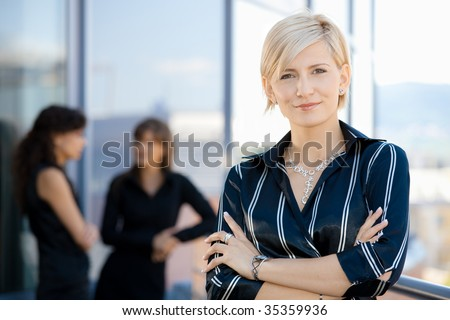 Outdoor portrait of attractive young businesswoman, smiling. - stock photo