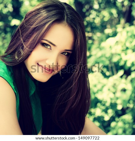 outdoor portrait of beautiful girl, image toned and noise added - stock photo