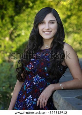 Outdoor portrait of beautiful hispanic young girl - stock photo