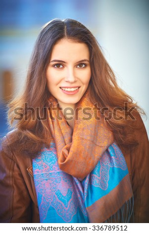 Outdoor portrait of beautiful redhead young woman - stock photo